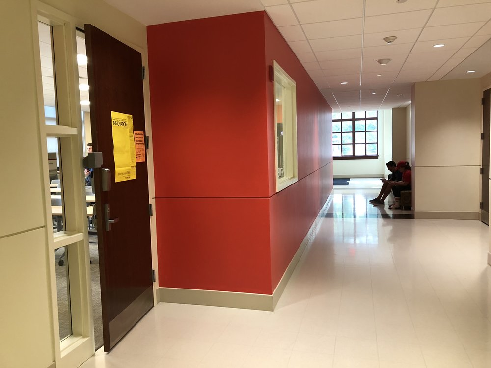 View of the MIX Lab door in the hallway. The only red wall in the School of Business building.