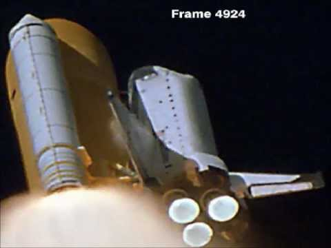 Frame of NASA launch footage showing the moment the foam struck the shuttle's left wing (Creative Commons)