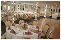 The Centennial Room - This serves as the master ballroom complete with adjustable lighting for ambiance, a complete wet bar, round tables, beige leather chairs, and decorative mirrors on the walls. It can seat up to 200 guests and has a private dance floor.