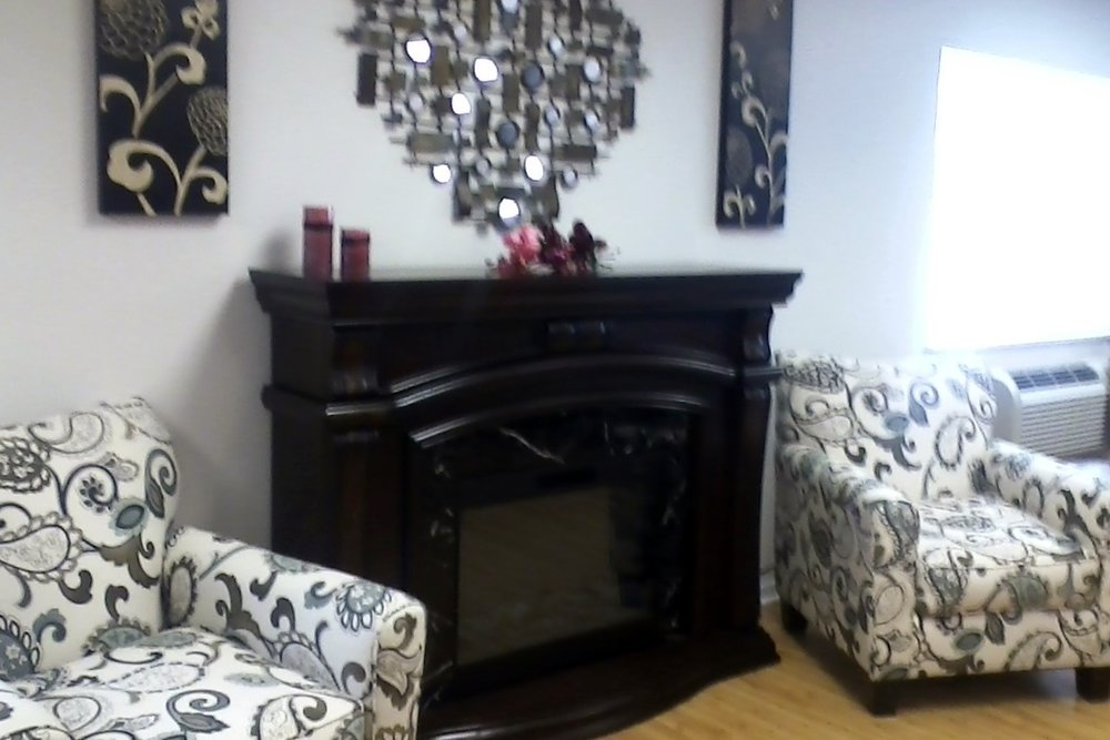 Fireplace with 2 reading chairs.jpg