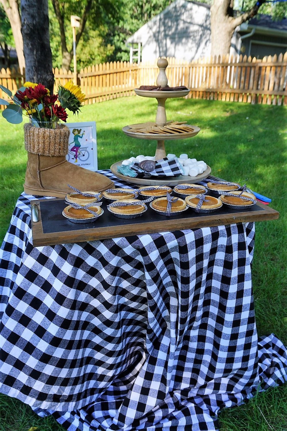 Buffalo check tablecloths are perfect for your fall dessert table. Your fall party guests will love these take home mugs! Click here to re-create this fun fall party! | Legally Crafty #fallparty #bonfire #girlsnightin #girlsnight #basicfallgirl