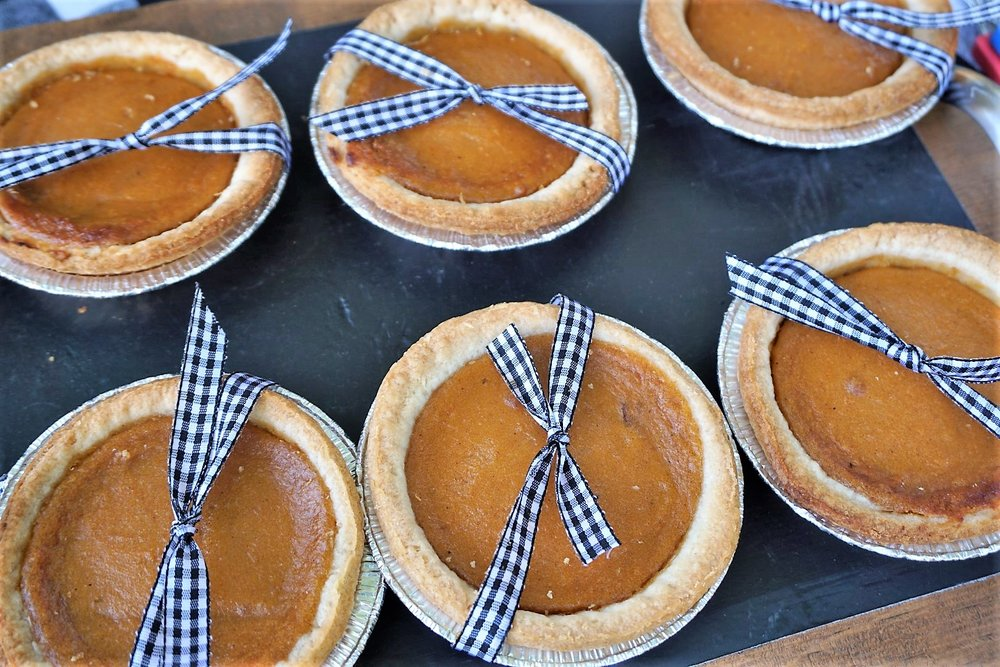 These mini-pumpkin pies are easy to make cute with plaid ribbon. Your fall party guests will love these take home mugs! Click here to re-create this fun fall party! | Legally Crafty #fallparty #bonfire #girlsnightin #girlsnight #basicfallgirl