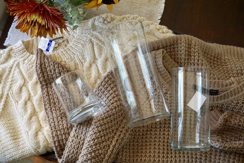 These supplies make cute decor, I promise. Click here to learn how to make these NO SEW sweater candles! | Legally Crafty #sweatercandles #diydecor #budgetdecor #fallcrafts #wintercrafts #thriftstoredecor