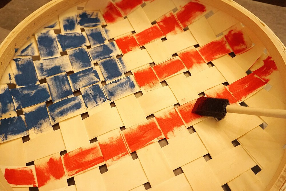 A plain basket being transformed into flag decor for 4th of July. An easy DIY project for 4th of July!