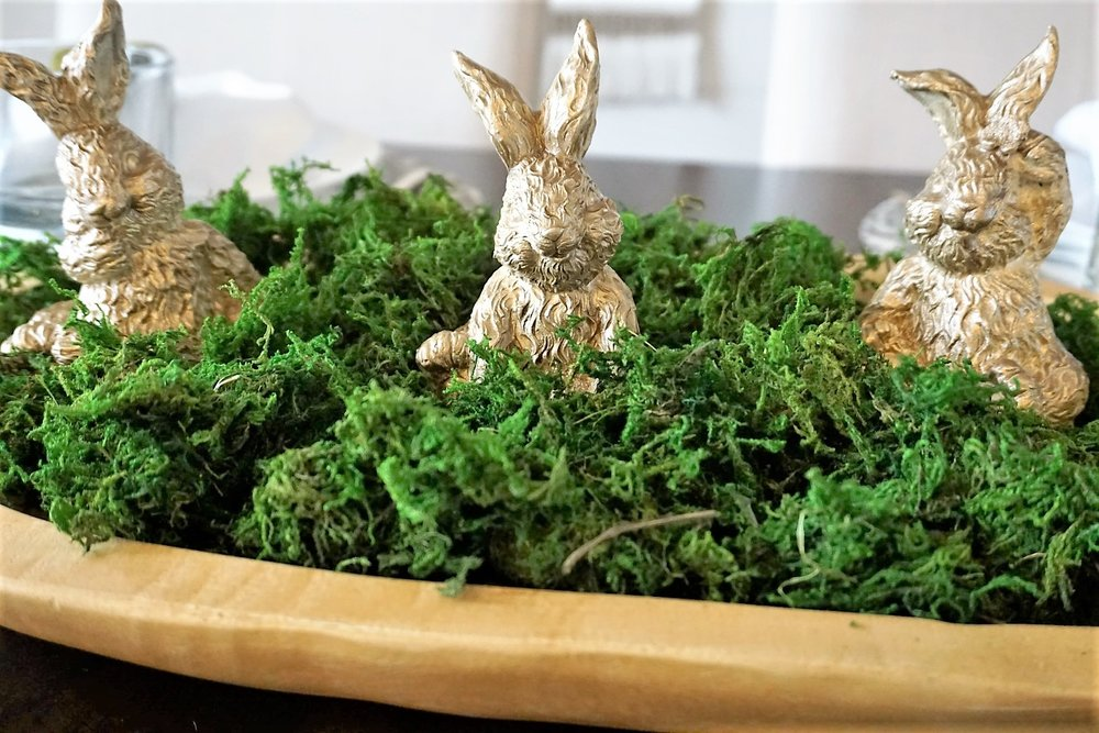 Thrift store Easter decor was spruced up with gold spray paint, green moss, and a dough bowl.
