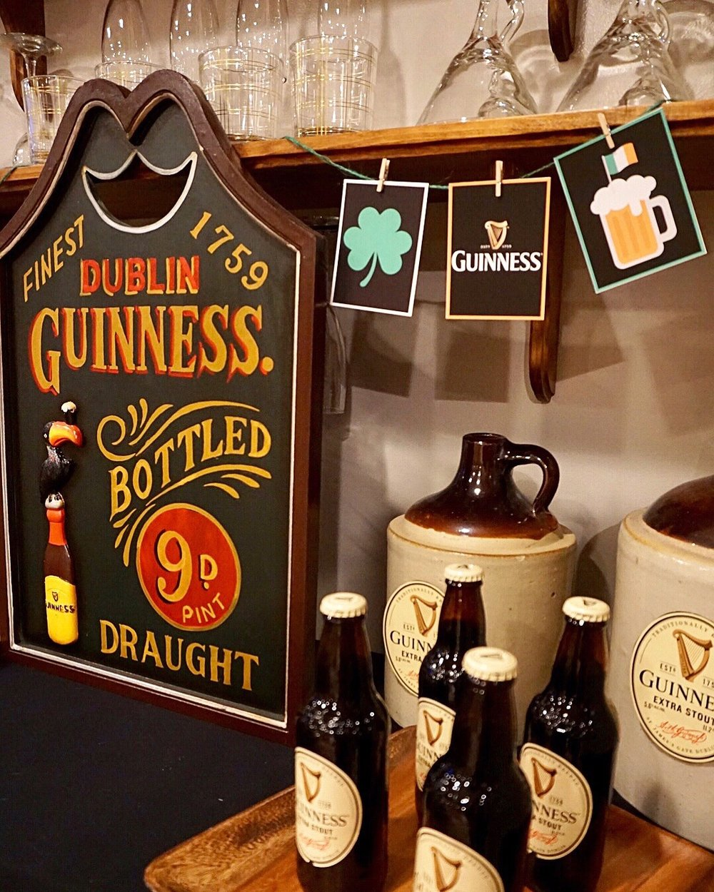 Make your own Guinness banner for your St. Patrick's Day bar or drink station with a free printable and some simple craft supplies.