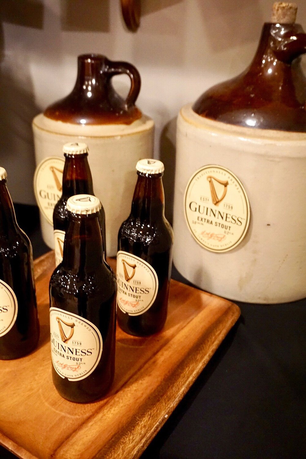 Turn vintage whisky jugs into Guinness decorations for your St. Patrick's Day party.