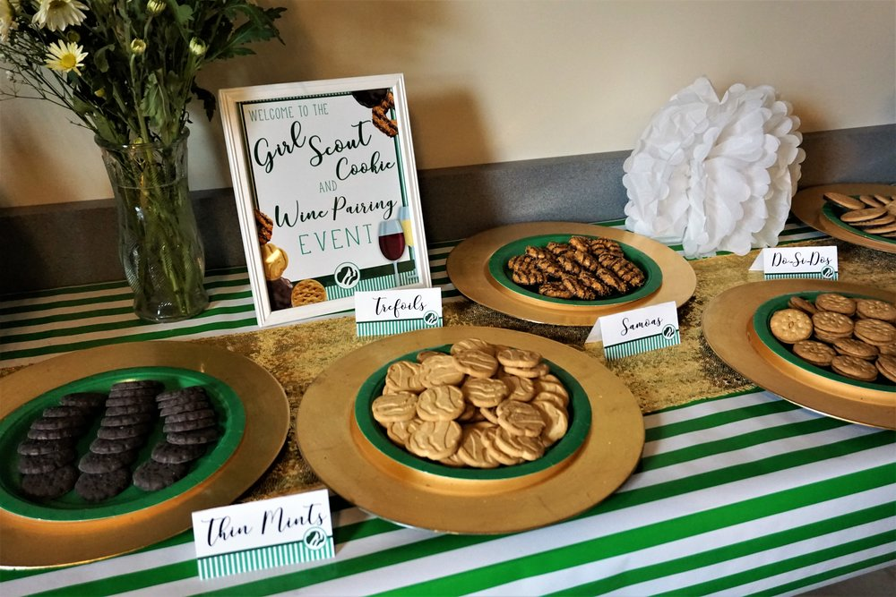 Use gold chargers and green plates to serve Girl Scout cookies at a Girl Scout cookie and wine pairing party.