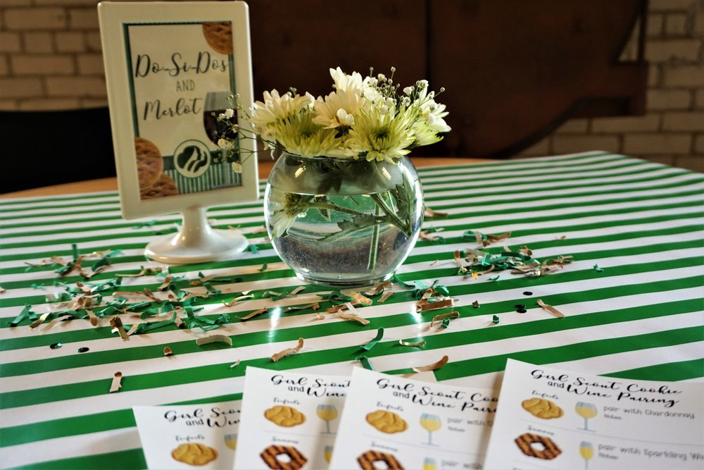 Daisy flower arrangements make the perfect table decor for a Girl Scout themed event.