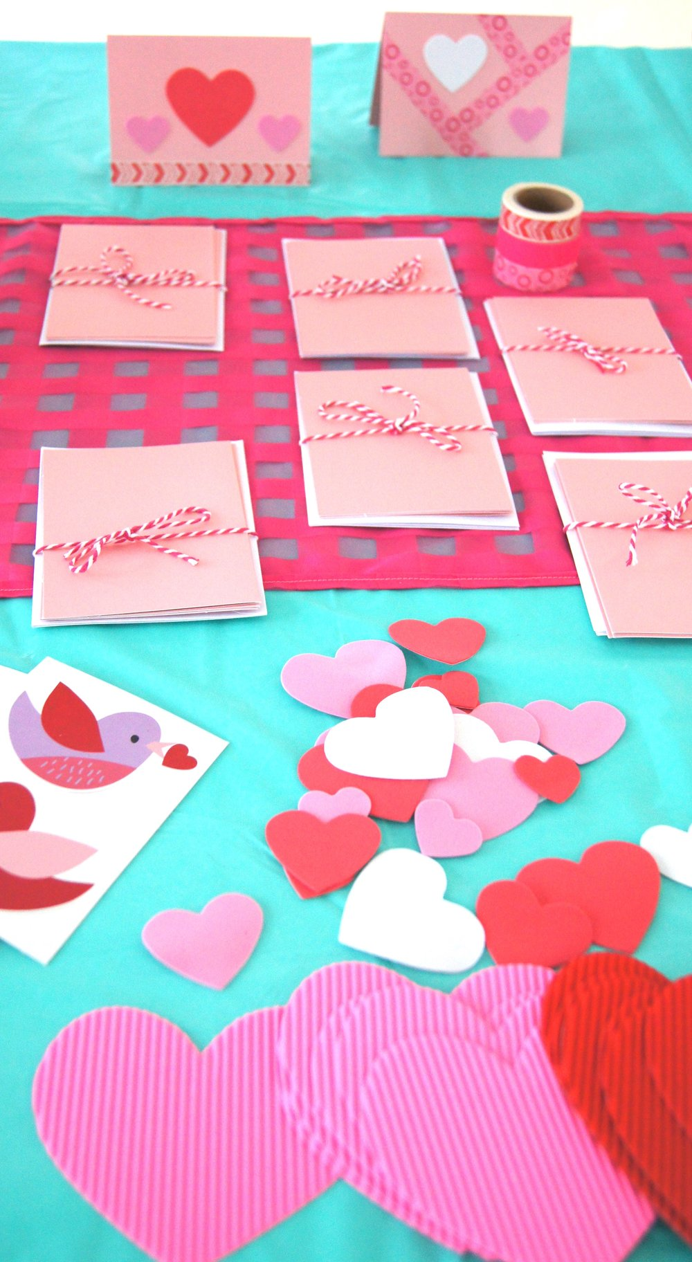 Make your own Valentine cards for friends of for kids in the hospital using blank cards, washi tape, and foam heart stickers.