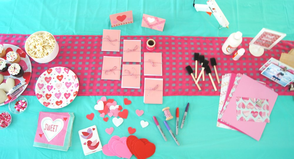Set up a craft station at a Valentine's Day play date for your girls.