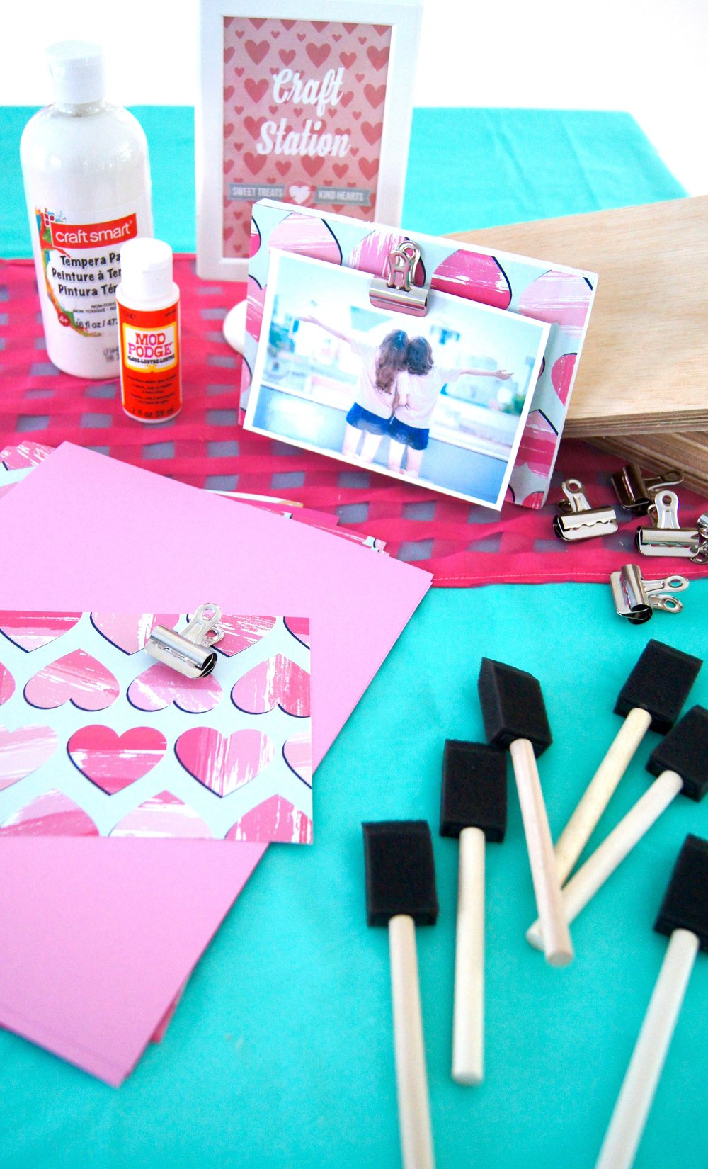 Wood, mod podge, paper, and a metal clip make a fun DIY frame for best friends for some Valentine's Day fun!