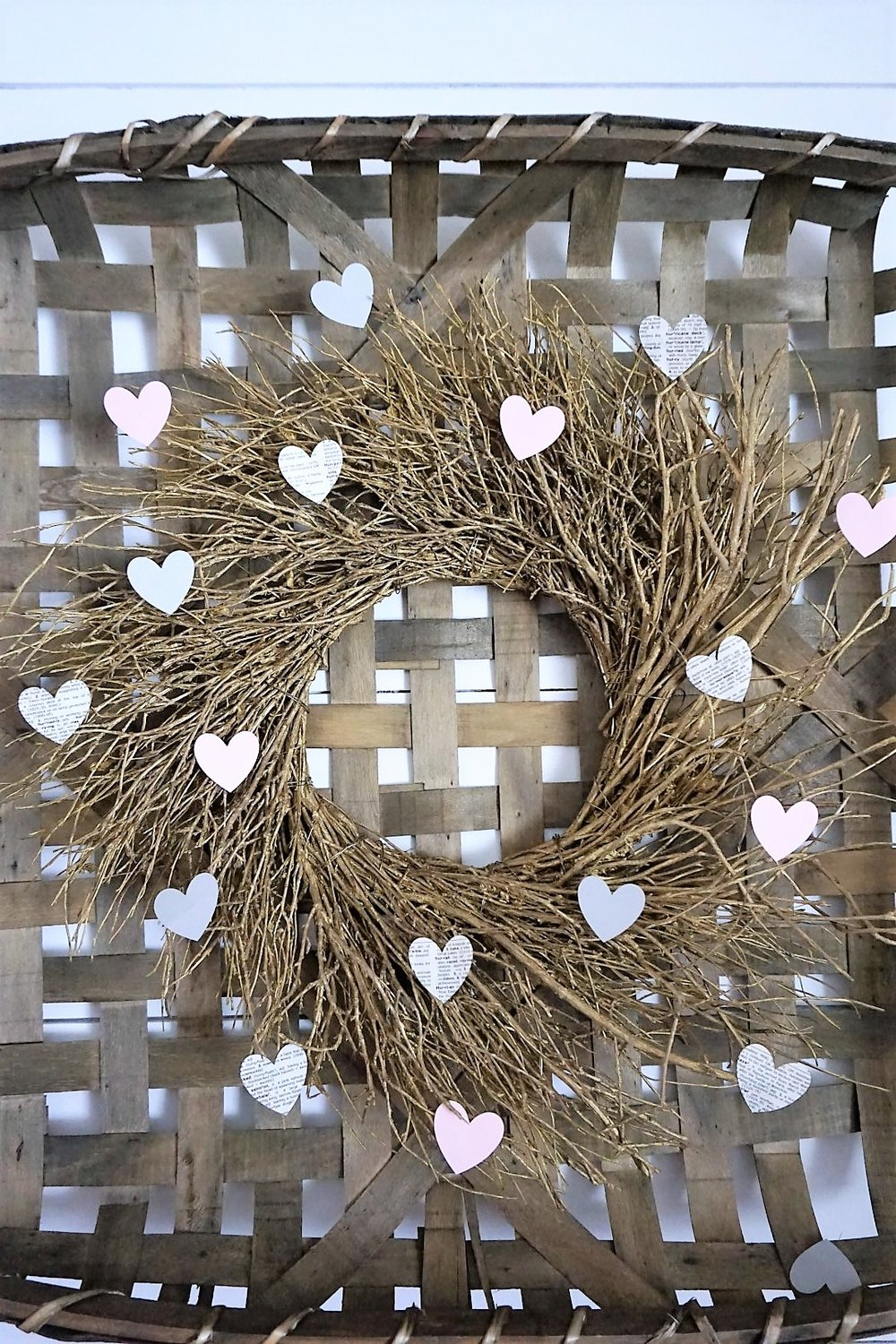 Decorate a store bought wreath with hearts for Valentine's Day decor.