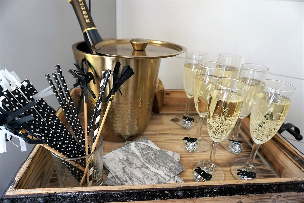 Pretty black and gold makes a perfect New Year's bar.