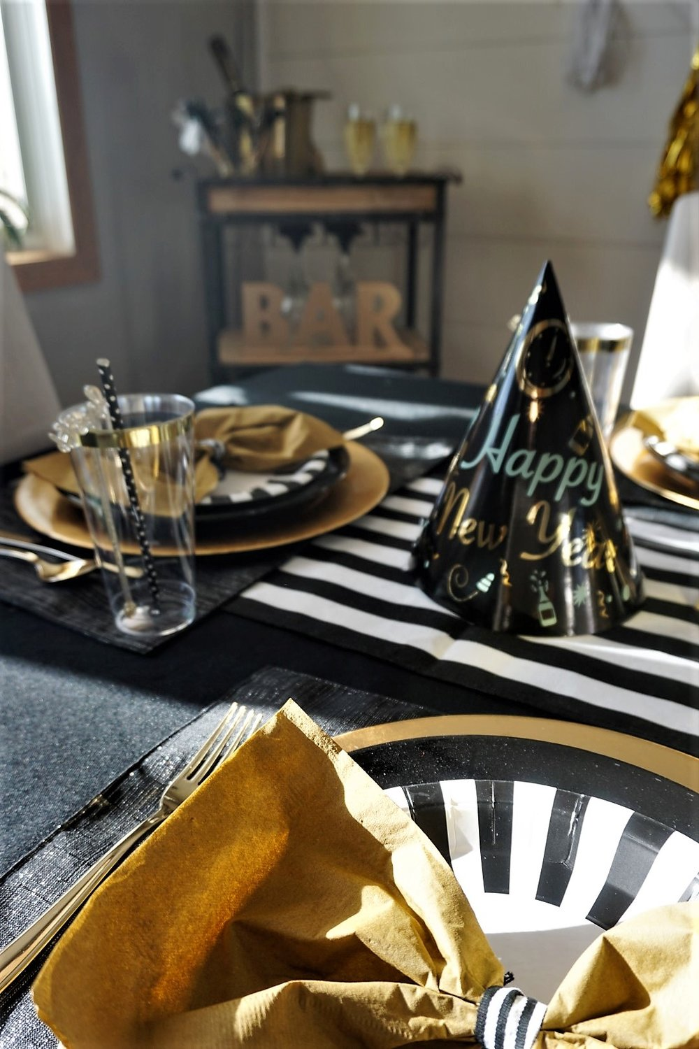 Black and gold makes your New Year's Eve table pop.