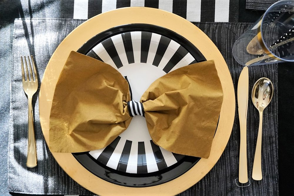 Make napkins into bow ties with a little bit of black and white striped ribbon.