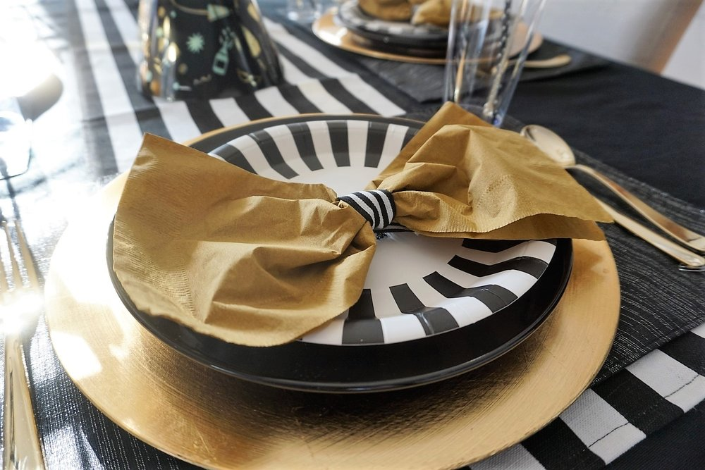 Display napkins as a bow tie using ribbon of your choice.