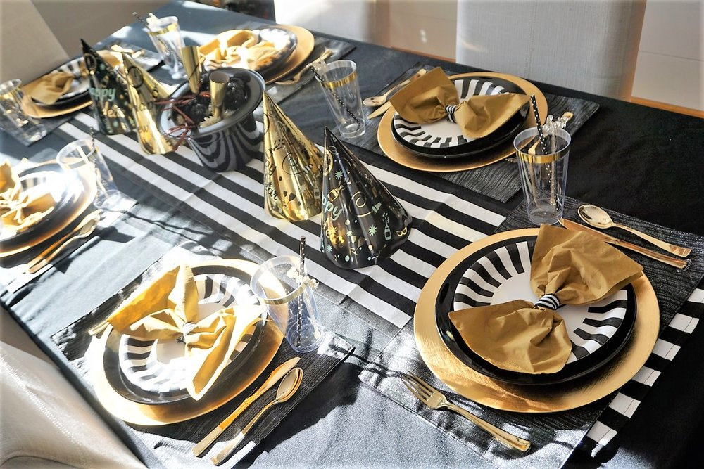 Use black and gold party hats and favors as your dinner table centerpiece for New Year's Eve.