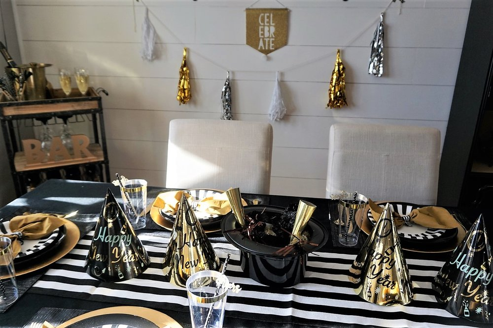 Black and gold New Year's Eve dinner party.