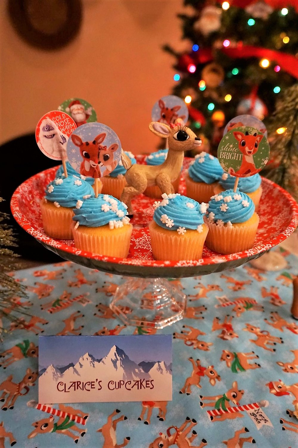 Create your own DIY Christmas Cupcake stand using a glass candle holder from Dollar Tree and a tin snowflake plate.