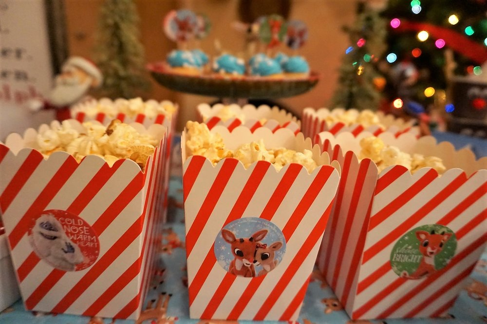 Use red and white striped boxes and stickers to create Rudolph themed popcorn treats.