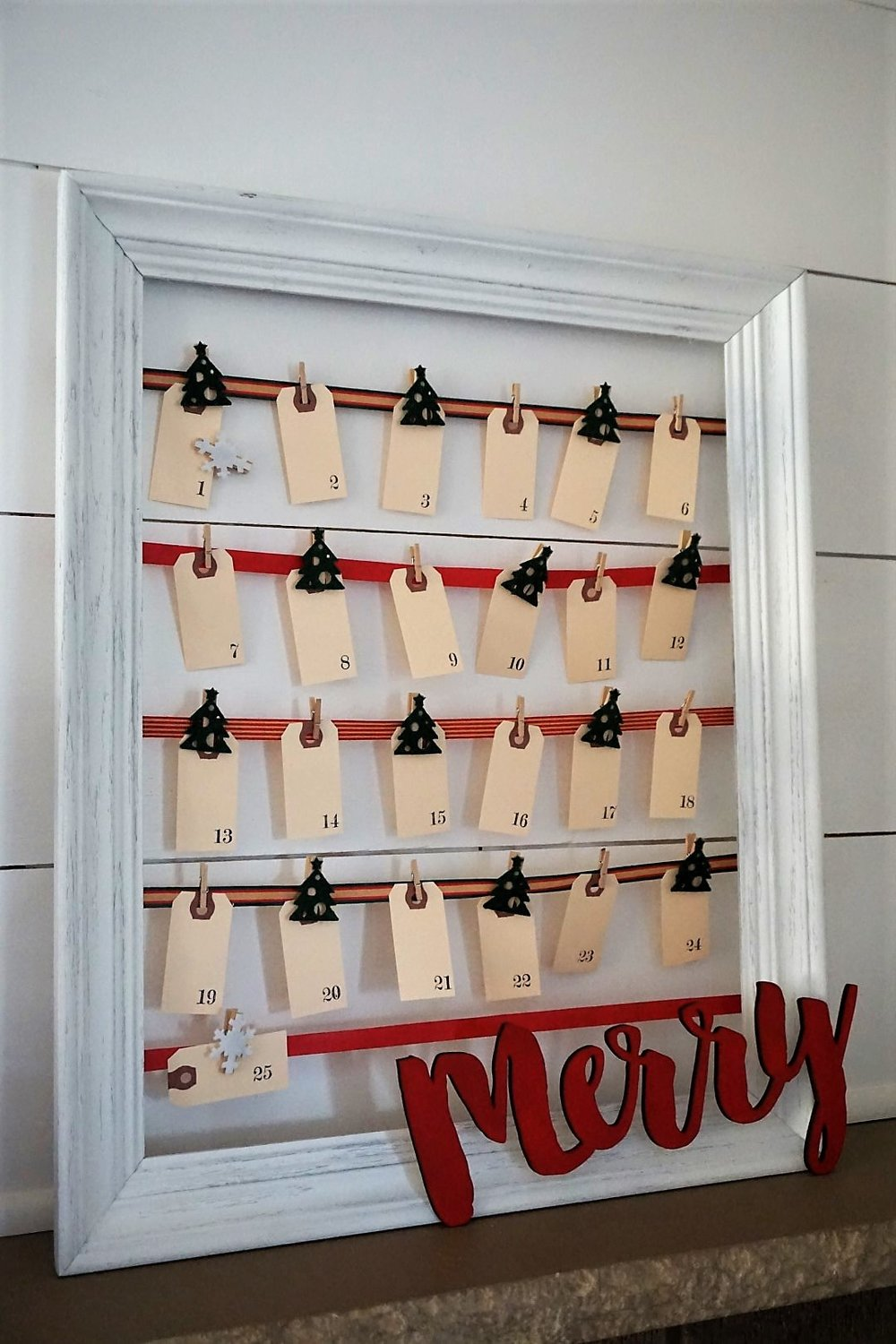 Stamped shipping tags make an adorable DIY advent calendar. Clip them on ribbon attached to a thrifted frame.