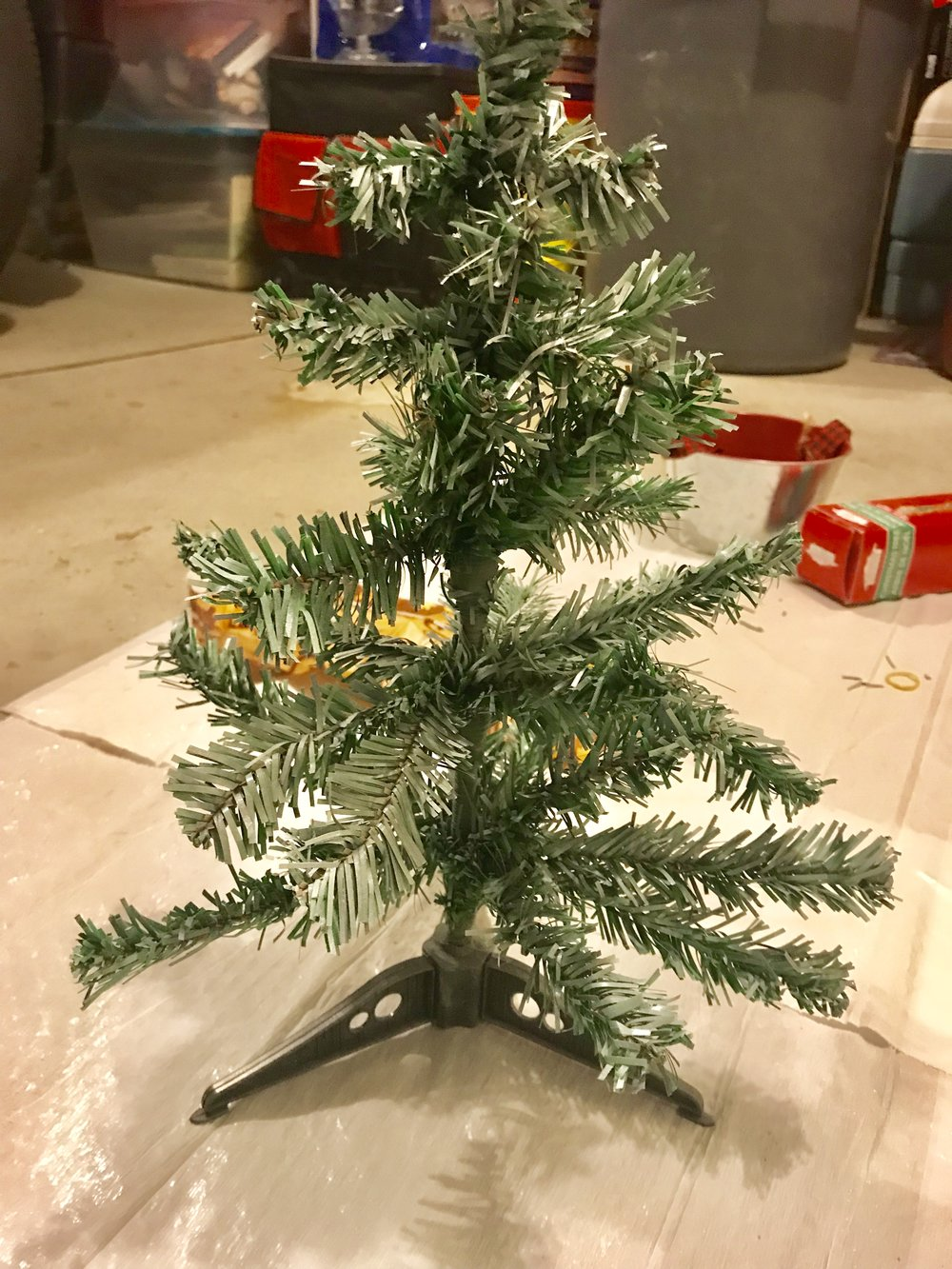 Christmas trees can be spray painted to give them a more rustic look.