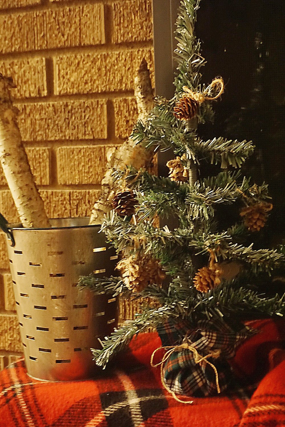 Adding Walmart pine cones to a spray painted Christmas tree gives it a farmhouse rustic look.