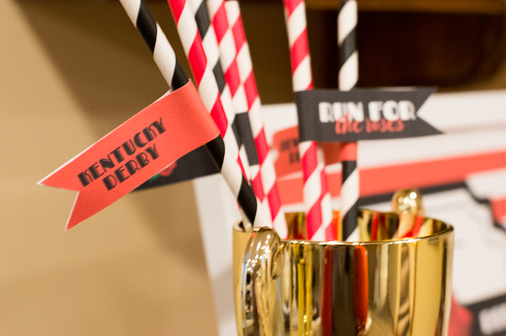 Straw flags dress up black and red paper straws for the Kentucky Derby.