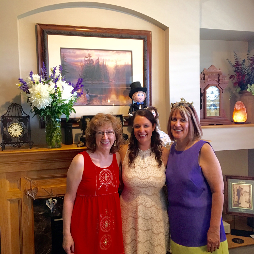My mother-in-law, me, and my mom at my travel themed bridal shower.