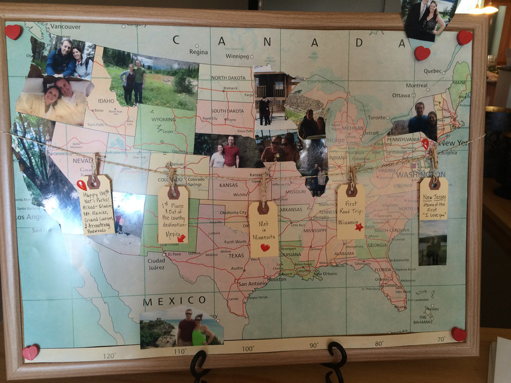United States map with pictures cut out into state shapes where the couple has been for a travel themed bridal shower.