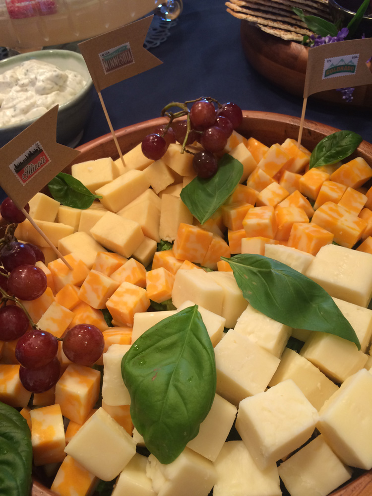 Cheese cubes with state toothpick flags in them for a travel themed bridal shower.