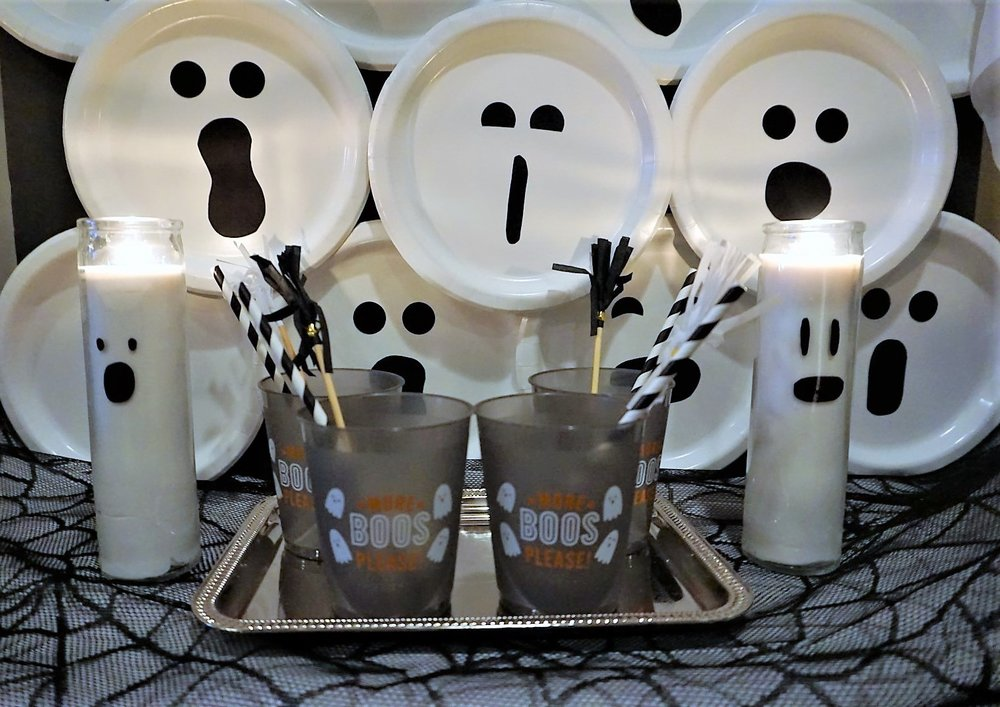 DIY Halloween ghost backdrop and DIY ghost candles. #halloweendiy #halloweenbar #moreboosplease #boobar #halloweencrafts