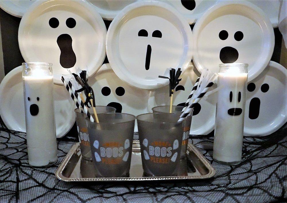 DIY Halloween ghost backdrop and DIY ghost candles. #halloweendiy #halloweenbar #moreboosplease #boobar #halloweencrafts