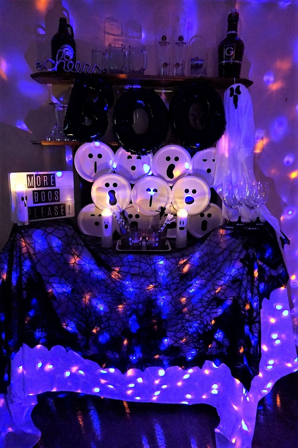 Purple and orange lighted Halloween bar using Points of Light LED display.