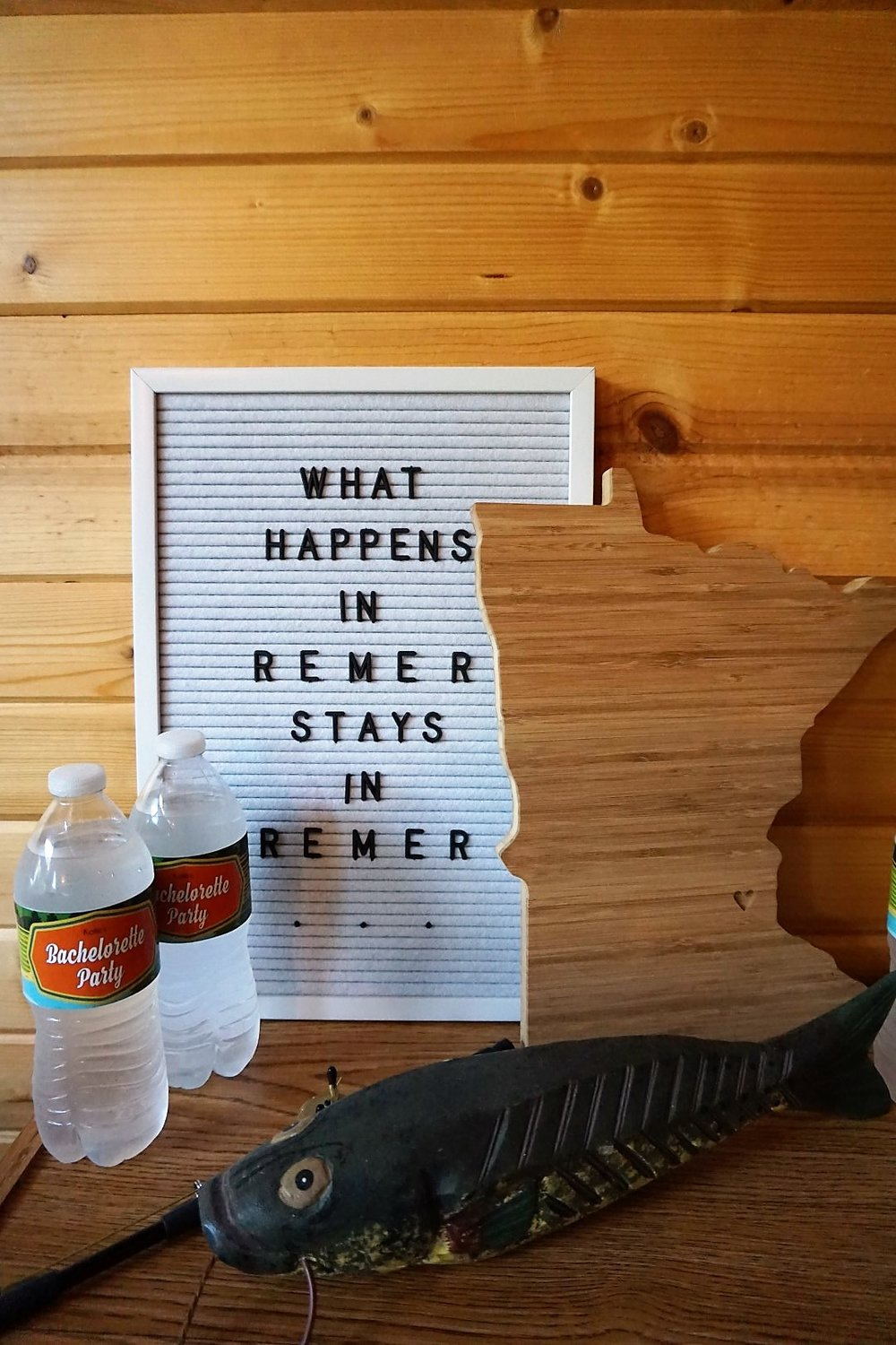Letterboard, Minnesota wood cutout, and fish decor are perfect for a cabin or lake themed bachelorette party.