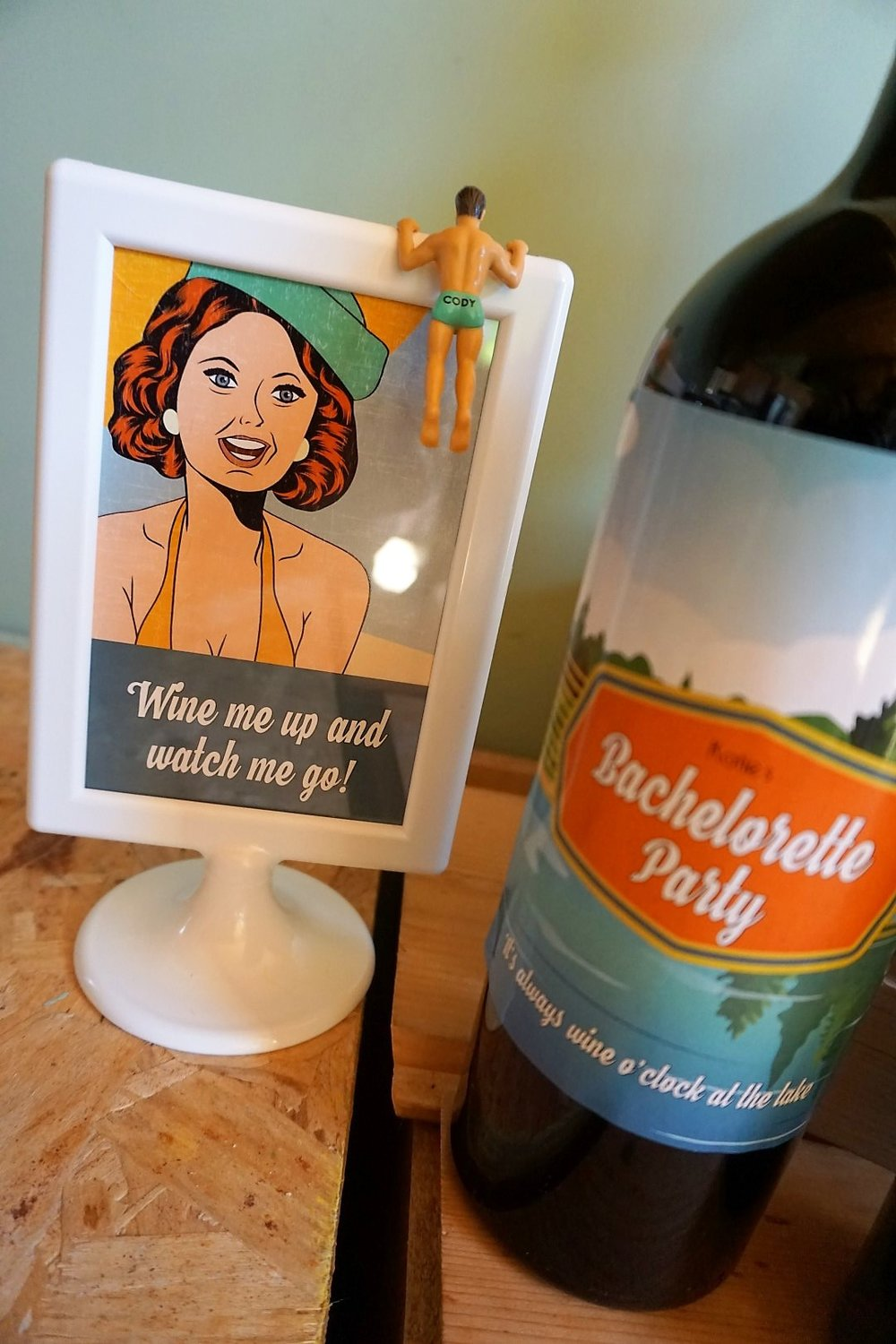 Retro signage and men wine markers for a bachelorette party.