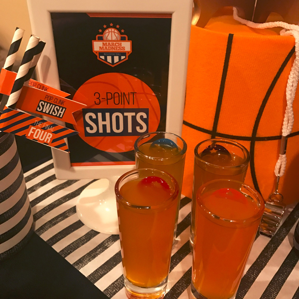 3 point shot drinks with sign for March Madness and basketball bar.