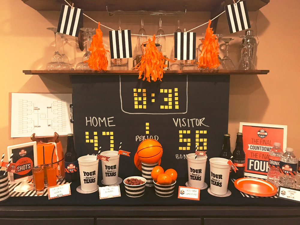 Basketball themed bar with DIY scoreboard backdrop and DIY banner.