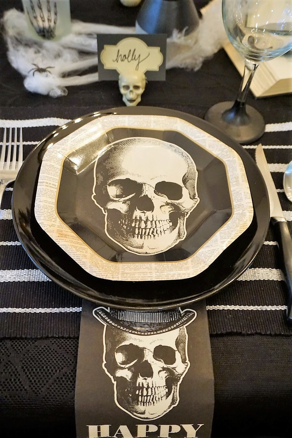 Vintage skull table setting with DIY placecard holder. Click here to see how to re-create this Halloween table! | Legally Crafty #halloweentable #halloweendiy #diyplacecards