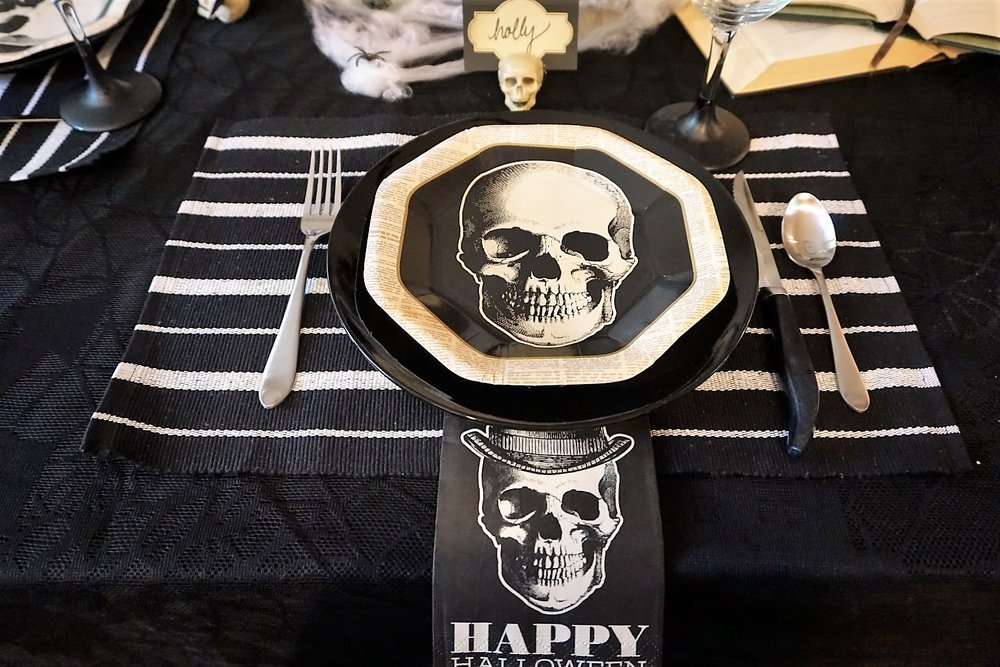 Dollar Tree placemat and plates make these table settings pop. Click here to see how to re-create this Halloween table! | Legally Crafty #halloweentable #halloweendiy #diyplacecards