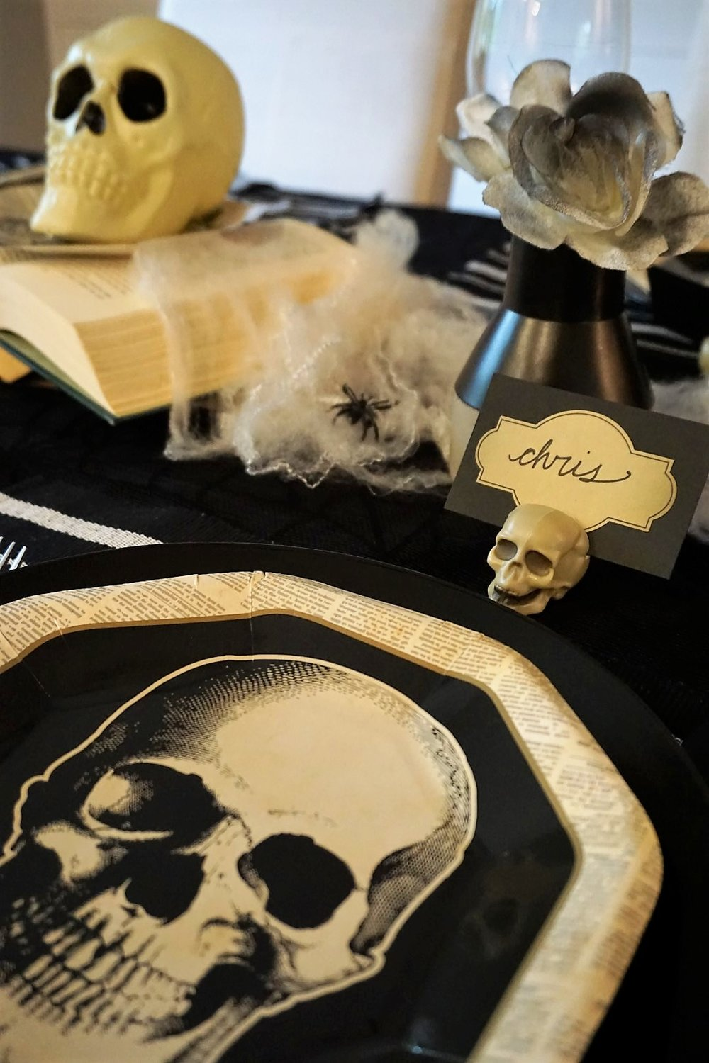 This year I was loving the vintage skull vibes! Click here to learn how to recreate this Halloween tablescape on a budget! | Legally Crafty #halloweendiy #halloweentable #halloweentablescape #halloweendiy