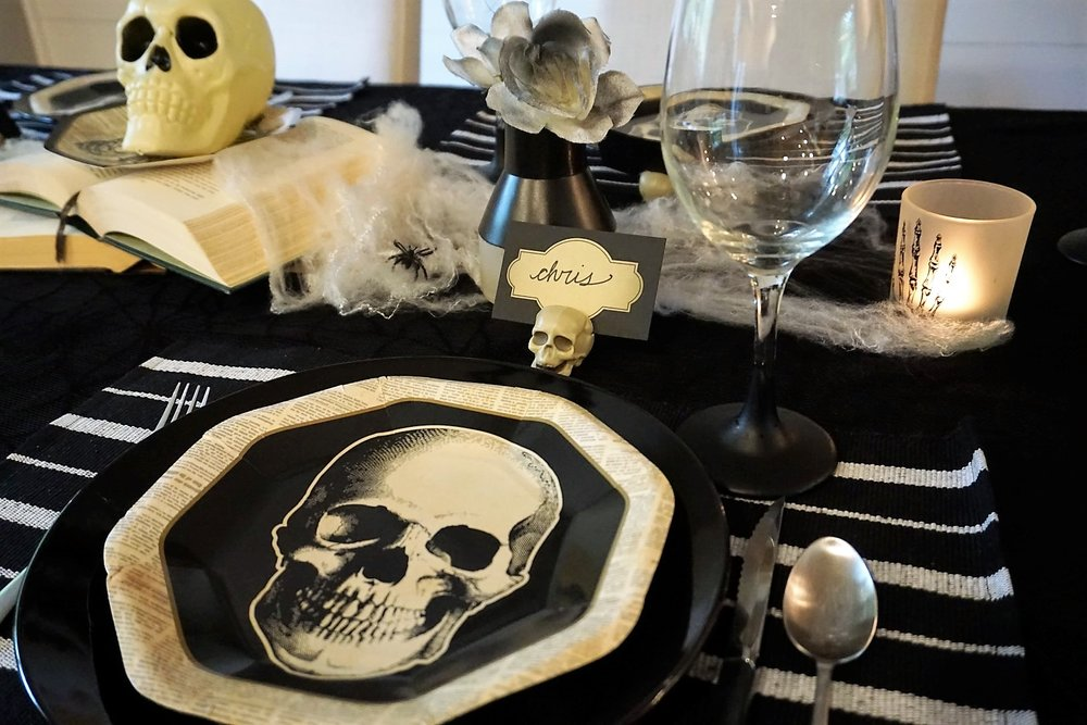 Spooky chic doesn't have to be expensive. Click here to see how to re-create this Halloween table! | Legally Crafty #halloweentable #halloweendiy #diyplacecards #halloweendecor #halloweendinnerparty