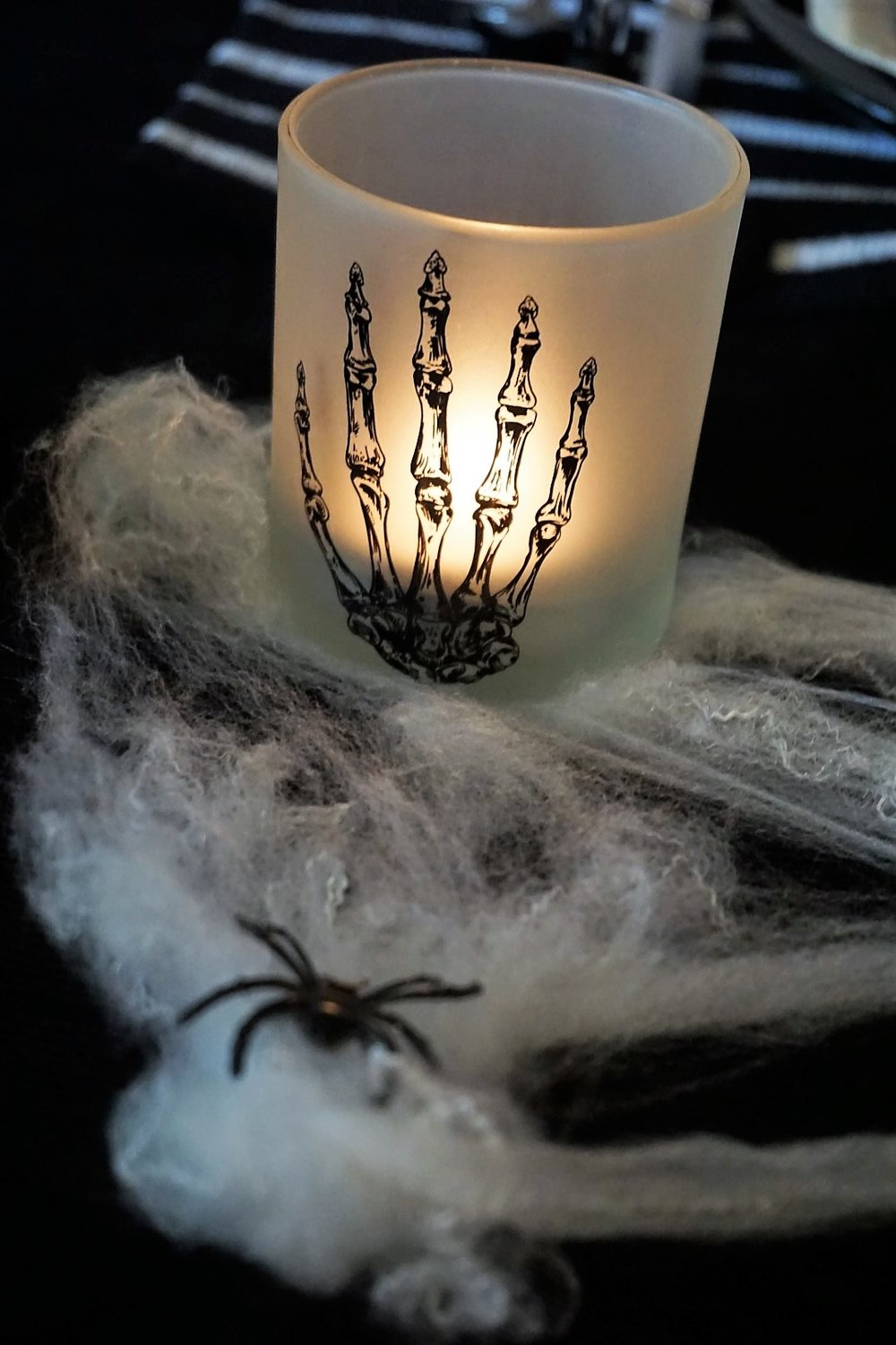This pretty candle was a Dollar Tree find! Spooky chic doesn't have to be expensive. Click here to see how to re-create this Halloween table! | Legally Crafty #halloweentable #halloweendiy #diyplacecards #halloweendecor #halloweendinnerparty