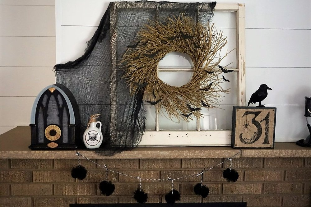 Halloween mantel with DIY bat wreath. #halloweendiy #halloweendecor #halloweenwreath #batwreath