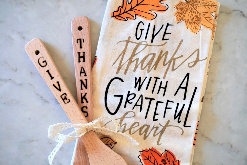 Handmade wood burned utensils paired with a tea towel makes for a great Thanksgiving hostess gift!