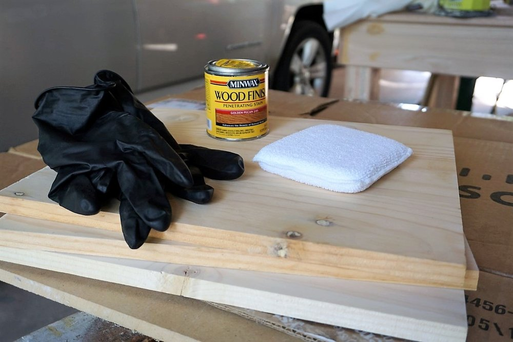 Staining gloves, wood stain, staining pad, and wood boards to make wood chargers.