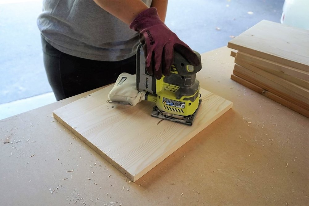 Using Ryobi sander to smooth out wood for chargers.