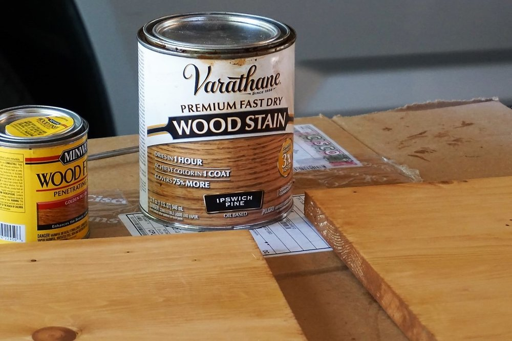 Mix two stain colors to achieve a desired color for the wood.