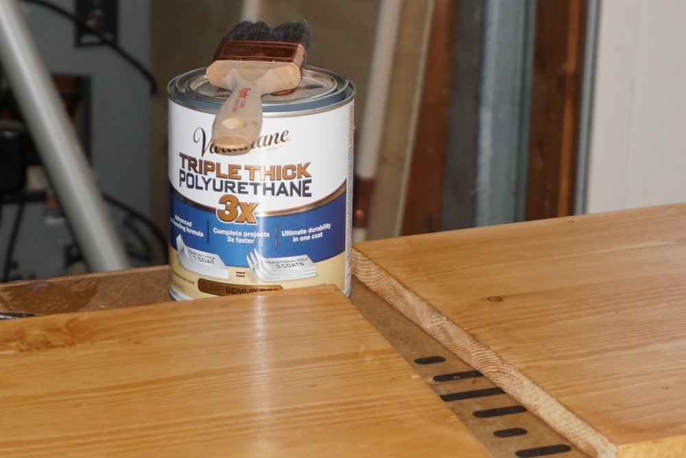 Apply polyurethane with paint brush to seal wood chargers.